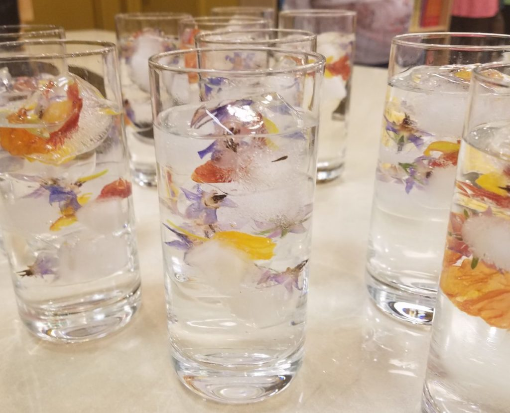 Floral Ice cubes made using nasturtium petals, borage flowers, violas and pineapple sage blossoms during Chef Christy's Herbal Drinks and Snacks class
